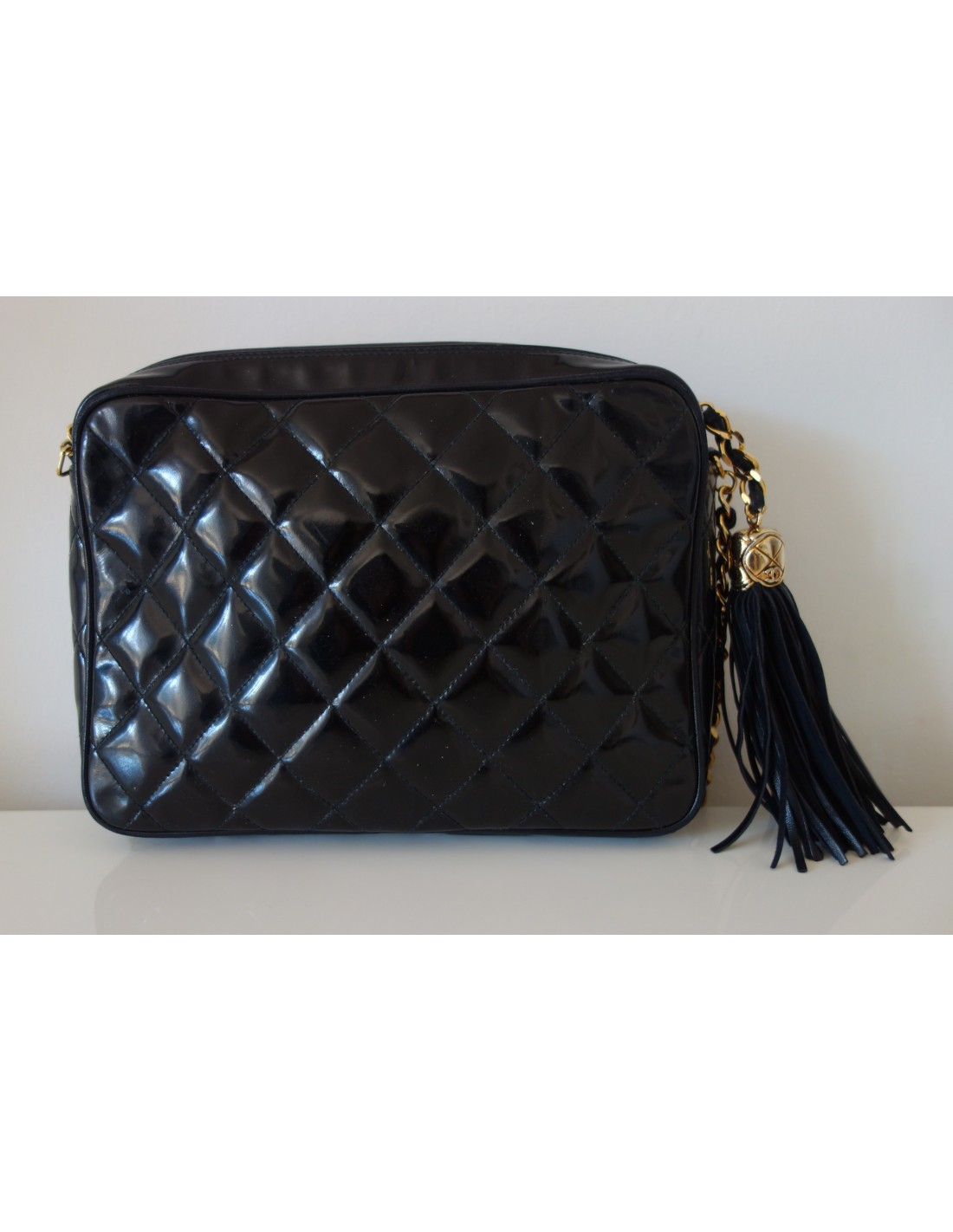 Sac chanel vintage pompon atoutluxe boutique for Sac chanel interieur